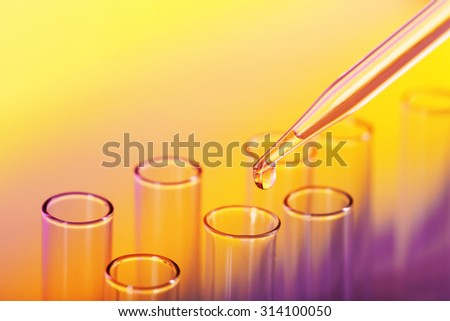 Test tubes on color background - stock photo