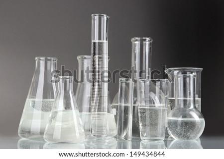 Test tubes on gray background - stock photo