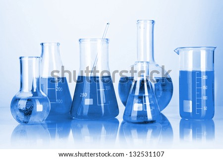 Test tubes with colorful liquids in blue light