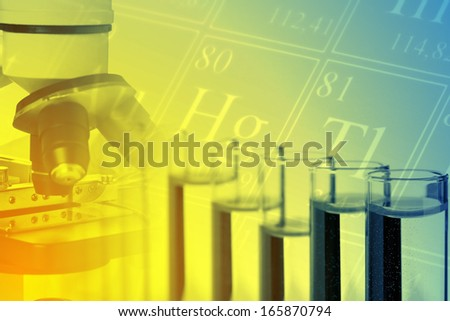 Test tubes with microscope and periodic system of the elements - chemistry or biology science background - stock photo