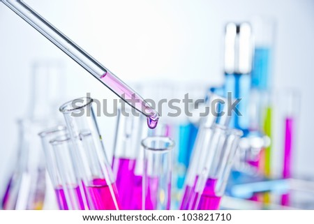Test tubes with pipette - stock photo