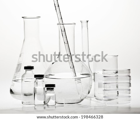 Test-tubes with reflections on a white background. Laboratory glassware. - stock photo