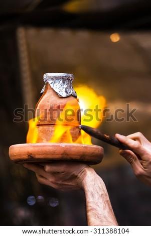 Testi or Tandir Kebab prepared in ovenproof clay pot - stock photo