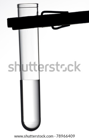 testtube filled with toxic liquid with clamp - stock photo