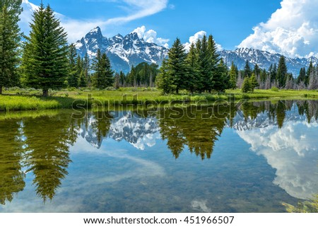 Teton Range and Snake River - Spring view of Teton Range rising at side of calm Snake River in Grand Teton National Park, Wyoming, USA.
