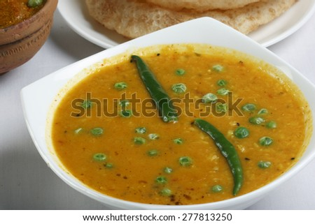 Tetor dal made of moong dal cooked with fried bitter gourd (karela) slices and fresh spices - stock photo