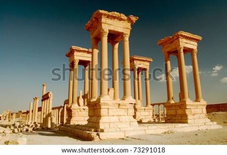 Tetra pylon in ancient city of Palmyra located in Syrian desert.