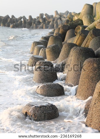 Tetrapods made of concrete protect the beach on Sylt  - stock photo