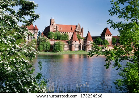 Teutonic castle in Malbork with reflection in Nogat river