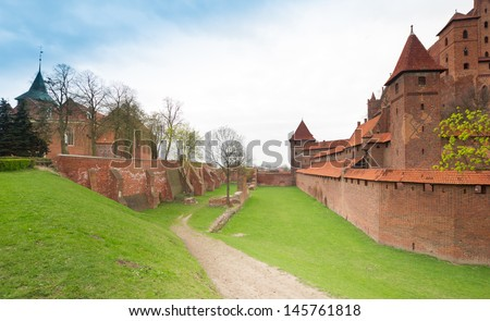 Teutonic castle Malbork in Pomerania region of Poland. UNESCO World Heritage Site. Knights' fortress also known as Marienburg. - stock photo
