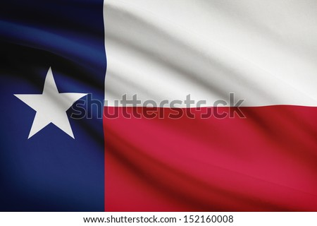 Texan flag blowing in the wind. Part of a series. - stock photo