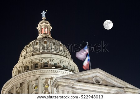 Texas Capitol on a full moon night in Austin.