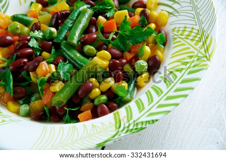 Texas caviar -  mixes black beans and  peas with jalapeno peppers, cilantro, corn and bell peppers.
