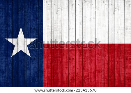 Texas flag and wood background - stock photo