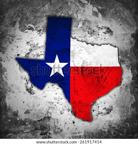 Texas flag,map and wall background - stock photo