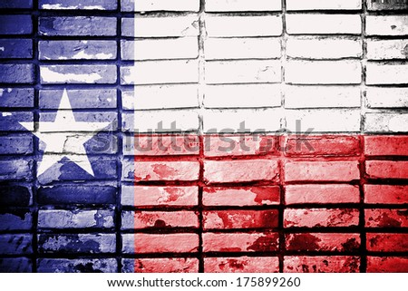Texas flag paint on old brick wall - stock photo