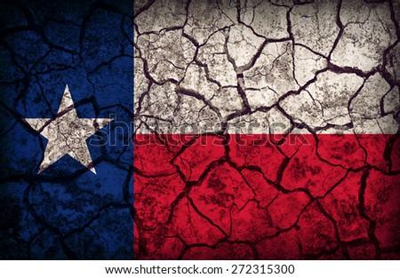 Texas flag pattern on crack soil texture,retro vintage style - stock photo