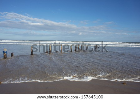 Texas Gulf coast beach at Padre Island after a storm. - stock photo