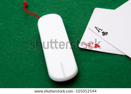 Texas holdem pocket aces on casino table with internet stick con - stock photo