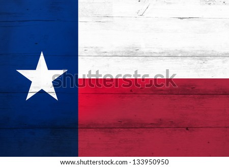 Texas Lone Star Flag on barn wood (aged) - stock photo
