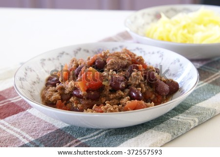 Texas style Chili with spaghetti squash. Healthy home cooked meal concept that fits with Paleo, low carb and clean eating lifestyles.