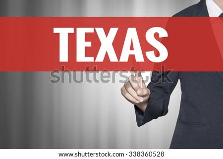 Texas word on virtual screen push by business woman red tab - stock photo