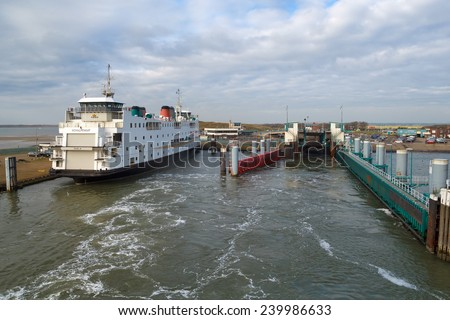 TEXEL, NETHERLANDS - NOVEMBER 2014: View on ferryboat Schulpengat from a ferryboat just leaving the Island Texel heading for the main land on November 17th, 2014, near Texel, the Netherlands.
