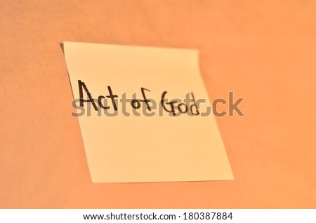 Text act of god on the short note texture background