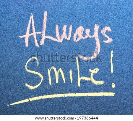text always smile on blue paper - stock photo