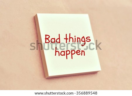 Text bad things happen on the short note texture background - stock photo