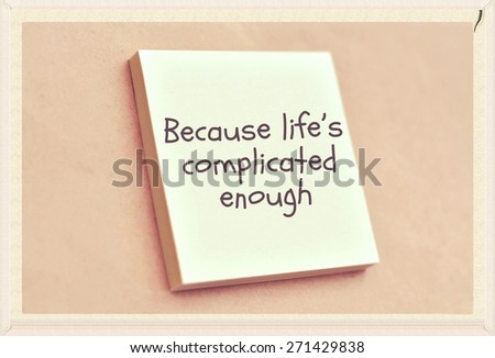Text because life's complicated enough on the short note texture background - stock photo