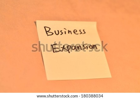 Text business expansion on the short note texture background
