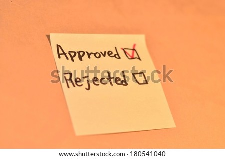 Text checked approved and rejected on the short note texture background