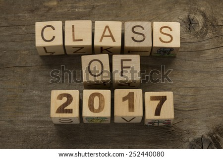 Text Class of 2017 on a wooden background - stock photo