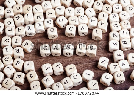 Text concept macro: Letter dices forming word games - stock photo
