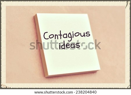 Text contagious ideas on the short note texture background - stock photo