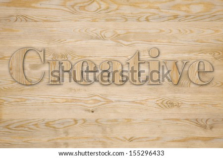 Text CREATIVE made of wooden letters on wooden background