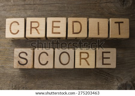 text CREDIT SCORE on a wooden bacground