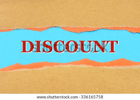 text discount on a torn paper - stock photo