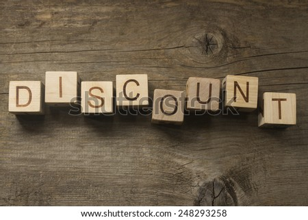 text discount on a wooden background - stock photo