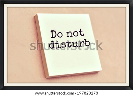 Text do not disturb on the short note texture background - stock photo