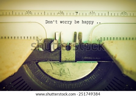 text Don't worry be happy  on the vintage typewriter in vintage color - stock photo