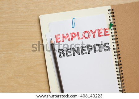 Text employee benefits on white paper and pencil / business concept