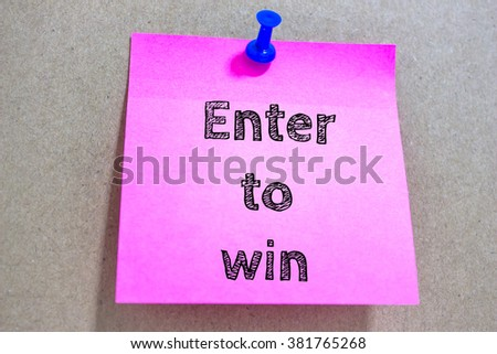 Text Enter to win on paper note / business concept - stock photo