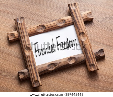 Text Financial Freedom written on wood frame - stock photo
