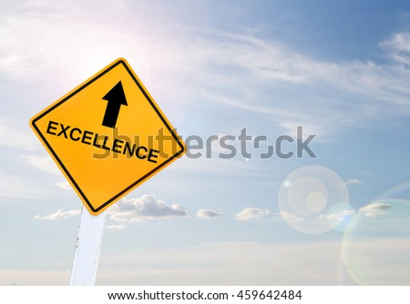 Text for EXCELLENCE on yellow road sign with blur blue sky background