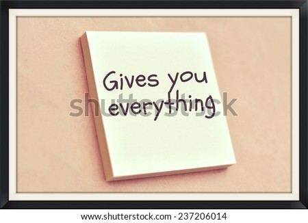 Text gives you everything on the short note texture background - stock photo