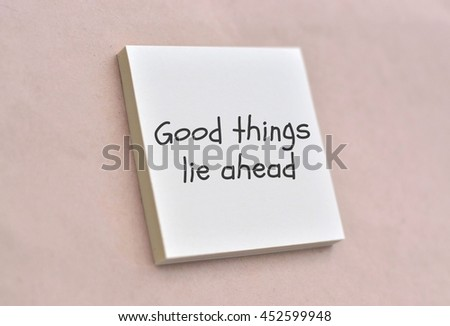 Text good things lie ahead on the short note texture background