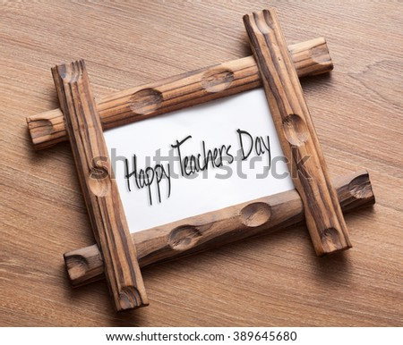 Text Happy Teachers Day written on wood frame - stock photo
