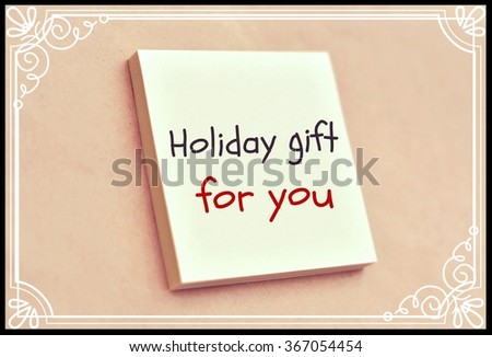 Text holiday gift for you on the short note texture background - stock photo